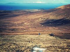 Exploring the Quirang on Skye, ascending Bioda Buidhe with the white hills of the Isle of Harris beyond (HighlandArt13) Tags: biodabuidhe quirang skye isleofskye scottishhighlands scotland islands hebrides hillwalking trotternish ridge