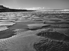 Low tide at Croyde (Rob Hall -) Tags: sea beach monochrome devon low tide horizon sun pools water reflection light blackwhite