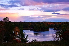 October Sunset Over St. Lawrence River II (barbarasimpson_photography) Tags: 1000islands stlawrenceriver jonescreek autum weekend foliage bluesky sunset pretty environment ontario canada sumac dusk trees maples colour red orange white green purple lavender water majestic