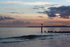 Sunset (Jim-Paterson) Tags: coast beach sky groyne sunset landscape bird perch wave dorset clouds