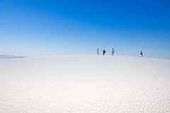 Walking Through White Sands (Stuck in Customs) Tags: newmexico stuckincustoms treyratcliff whitesands rr dailyphoto horizontal colour color day outdoor outside outdoors whitesand desert sunset dusk orange red white blue people sun glow bright elpaso sony ilce7rm2 august 2015 p2017 mountain sky cloud sunray dunes sanddunes