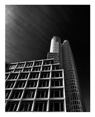 dark skies (kurtwolf303) Tags: buildings gebäude contrasts kontraste monochrome dark dunkel berlin germany deutschland windows fenster hochhaus olympusem1 omd microfourthirds micro43 systemcamera mirrorlesscamera spiegellos sky himmel architektur architecture 250v10f city stadt cityscape einfarbig kurtwolf303 500v20f topf25 topf50 topf75 bw 750views 900views topf100 1000v40f 1500v60f topf150 skyscraper wolkenkratzer sw 2000views 2500views