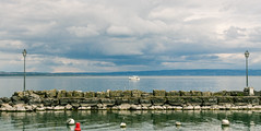 Yacht in the bay (gregory.sevin) Tags: yacht boat lamp posts bay lake natural pier yvoire france