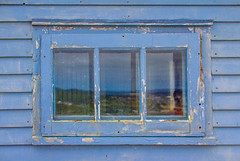 St. John's in the window (Ladonite) Tags: road trip travel blue sky canada reflection window glass vintage newfoundland peeling paint labrador explorer great rustic canadian adventure explore journey frame the