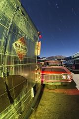 Traffic Jam (Aztravelgrl (Forgotten Places Photography)) Tags: california nightphotography usa lightpainting abandoned moonlight startrails mojavedesert movieprop paulsjunkyard