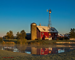 Rural Reflections ....(HWW) (jackalope22) Tags: autumn mist windmill barn rural reflections pond farm silos hww