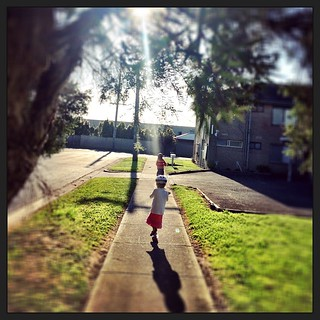 365/280 • on the way to put up the jumping castle at the kindergarten market - it's a beautiful morning! • #2014_ig_280 #scooters #4yo #6yo #suburbia #sunshine #community @hastingstoylibrary #morningtonpeninsula