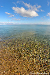 Lake Michigan ... blue sky, gravely day (Ken Scott) Tags: usa fall beach october rocks stones michigan fallcolors bluesky lakemichigan greatlakes hdr freshwater 2014 leelanau colortour 45thparallel longmuircottage kenscottphotography kenscottphotographycom