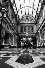 Killing Time (Idreamofpies) Tags: city uk windows light portrait england urban white black canon shopping photography blackwhite waiting iron doors britain patterns centre bricks great arcade ceiling lancashire miller tiles seats dome ironwork seating johnsons brickwork minton struts hollins idreamofpiesphotography