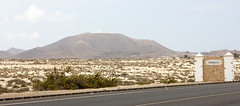Welcome to Corralejo (Five Second Rule) Tags: sea summer sun holiday mountains hot beach sign landscape dessert town spain dunes fuerteventura dry hills volcanic barren canaryislands moonscape sanddunes 2014 corralejo