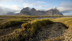 Hills of Hofn (Insidiator) Tags: travel autumn vacation mountains beach grass clouds landscape iceland perspective bluesky east leisure peaks distance whiteclouds hofn stokksnes