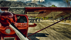 Palm Springs Aviation Expo 2014 (hbmike2000) Tags: street red sky usa sunlight mountain reflection clouds plane airplane nikon shiny palmsprings wing coachellavalley d200 propeller 2014 hss riversidecounty sanjacintomountain aviationexpo sliderssunday hbmike2000 palmspringsaviationexpo