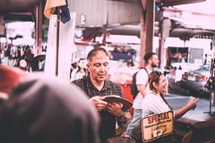 Hat Vendor (Jon Cartledge) Tags: flinder melbourne vendor lens prime vintage saturated golden cuts cold deli butter produce markets victoria vic market people street colour f2 40mm mrokkor minolta konica finder range seiko rd1s rd1 leicam rangefinder leica vignetting pastel dreamy toning shadow contrast warm smooth queen hat group