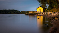 The Last Light (Jens Haggren (off for a while)) Tags: sunset light sea yellow house shore rocks water landscape nacka sweden jenshaggren