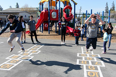 BW20170329-009.jpg (Menlo Photo Bank) Tags: hopscotch winter people classof2020 upperschool children menloschool 2017 taftelementary students girls communityservice largegroup event playground game boys photobypetezivkov atherton ca usa us