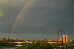 Rainbow over the milling district (schwerdf) Tags: bridges cloudscapes endlessbridge goldenhour guthrietheater hdr i35wstanthonyfallsbridge millingdistrict minneapolis minnesota rainbows thunderclouds