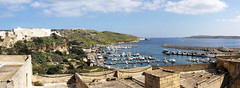 Panorama of Gozo harbour (Majorimi) Tags: canon eos 70d digital color colorful nice malta sea sky blue green bay rock mountain gozo island weather spring field flowers city old ships harbour ferry view panorama