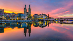 Limmatquai dawn (lukas schlagenhauf) Tags: limmatquai dawn bluehour purplehour limmat water river reflection morgenrot sunrise afterglow helmhaus grossmünster zurich clouds switzerland myswitzerland creativcommons cityscape