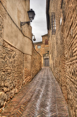 Street in Toledo (Jan Kranendonk) Tags: toledo spain spanish street buildings town europe historical old culture hdr sky rainclouds houses streetlight streetlamp cloud cloudy scenic landmark stone bricks door doorway ngc