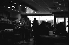 Lone Cup - a story? (Man with Red Eyes) Tags: nikonf3p f3 slr 50mmf14 ilford harman kentmere400 35mm film pyrocathd semistand analog blackwhite monochrome silverhalide vintage mechanicalcamera lancaster lancashire northwest coffeeshop cup underexposed cafe dof f14 wideopen lonely mug story