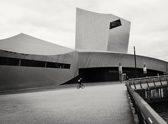 Cycle (Hilary Causer) Tags: imperialwarmuseum daniellibeskind mono blackandwhite cyclist salfordquays smartphonephotography phonography