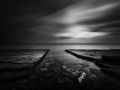 Separation (ilias varelas) Tags: longexposure light sea blackandwhite bw seascape water monochrome clouds contrast landscape mono rocks mood greece ilias ndfilter canonef1740mmf4l varelas canoneos6d