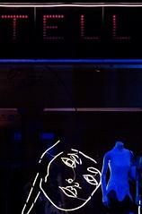 Stella McCartney, Bruton Street, Mayfair, London (chrisjohnbeckett) Tags: blue stella red london mannequin face fashion night design lowlight neon nightshot display tell availablelight shopwindow mayfair stellamccartney londonist canonef135mmf2lusm chrisbeckett