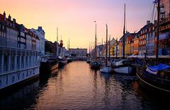 Nyhavn at Sunset in Copenhagen, Denmark (` Toshio ') Tags: sunset reflection history water architecture buildings copenhagen denmark restaurant harbor europe european ship ripple tallship europeanunion toshio
