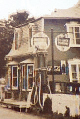 St. Jean Then & Now - IMGP6712 (catchesthelight) Tags: canada architecture island quebec porch quaint stjean stlawrenceriver decorativedetails isledorleans vintagegaspump swoopofroof cradleoffrenchcivilizationinnorthamerica