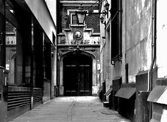 Clifford's Inn, but Everyone else is Out. (standhisround) Tags: door bw building london historic passage englishhistory cityoflondon chancerylane cliffordsinn