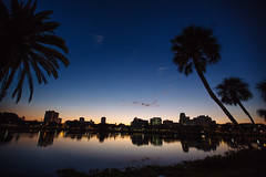 Mirror Lake (CityofStPete) Tags: park city morning blue trees sky orange lake water silhouette skyline clouds sunrise boats mirror harbor early am downtown waterfront ships salt parks front palm recreation yachts rec