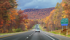 road autumn trees sky mountains sign clouds highway driving pennsylvania overcast hills foliage creativecommons highwaysign i80 exitsign appalachianmountains interstate80 unioncounty baldeaglestateforest milerun