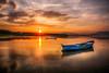 Last flares (Nejdet Duzen) Tags: trip travel sunset sun lake reflection turkey boat cloudy türkiye sandal günbatımı güneş göl yansıma turkei seyahat manisa bulutlu gölmarmara