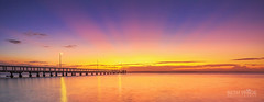 Dawn Rays (Beth Wode Photography) Tags: sunrays sunrise dawn morning morningsunrays dawnrays pinksunrays reflections wellingtonpoint redlands jetty pier wellingtonpointjetty beth wode bethwode seascape