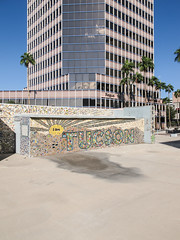 The mosaic is desirable but the 1986 skyscraper and the stained plaza are unsightly. (Tim Kiser) Tags: 1980s 1980sarchitecture 1986 1986architecture 1986building 2012artwork 2015 20151004 arecaceae arizona broadwayboulevard broadwayandstone iamtucson img4467 norwestbanktower october october2015 onesouthchurch palmae pimacounty pimacountyarizona regus southstoneavenue stoneavenue stoneandbroadway tucson tucsonarizona tucsonmosaic unisourceenergytower westbroadwayboulevard bekind cloudlesssky downtown downtowntucson highrise highriseofficebuilding moasic officebuilding palmtrees palms paved pavement plaza postmodernarchitecture postmodernskyscraper publicart skyscraper southarizona southeastarizona southeasternarizona southernarizona stainedpavement sunny unitedstates
