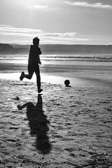 Beach ball boy (irishman67) Tags: blackwhite blackandwhite beach ball contranoir ireland light lahinch lehinch countyclare