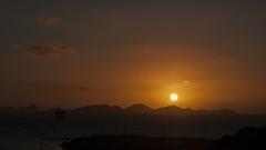 Sun rising over Peter Island - BVI (bvi4092) Tags: nikon d300s photoshop nikkor 18105mmf3556 outside outdoor nikon18105mmf3556 travel bvi britishvirginislands caribbean westindies sea sunrise dawn landscape sun sky clouds island