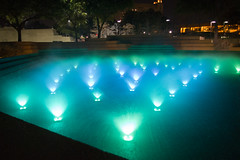 Light Dance (heatharcadia) Tags: fortworth texas water watergarden night nightphotography dark fountain postmodern architecture glow