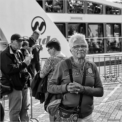 Heading for the open ocean (John Riper) Tags: johnriper street photography straatfotografie square vierkant bw black white zwartwit mono monochrome netherlands candid john riper canon rotterdam marine port worldportdays wereldhavendagen 6d 70200 l spido woman eye contact deep water desigual bag