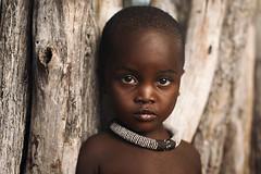 Innocence (Sean Tucker Photo) Tags: himba thehimba namibia paulcbuff photeksoftlighterii alienbee800 canon5dmkii canon sigma50mmart sigma50mmf14 tribe africa kamanjab onelight strobist travel travelphotography travelportrait portrait portraitphotography