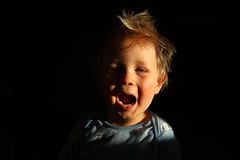 Yeah! (Ron and Co.) Tags: portrait face child toddler son happy people indoor naturallight blackbackground