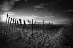 Passing through (Craigdrezek.com) Tags: yellow blackandwhite bw bnw monochrome beach sky sand fence nikon d7100 rhodeisland watchhill napatree serene calming tranquility mood landscape