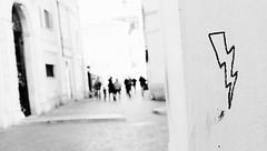 Bolt (lorenzoviolone) Tags: bw blackwhite blackandwhite dof finepix fujix100s fujifilm fujifilmx100s monochrome polaroid665 vsco vscofilm x100s bokeh cobblestone depthoffield graffiti lightning mirrorless shallowofdepth strangers streetphoto streetphotobw streetphotography walk:rome=dec292016 walking wall roma lazio italy