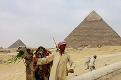 Man and Camel at Giza (Sound Quality) Tags: africa travel portrait man men history animal architecture canon landscape town sand technology tour desert pyramid outdoor african egypt streetphotography unesco explore cairo camel egyptian giza necropolis worldheritage bedouin greatpyramid aljizah canon50d spirit7628yahoocom
