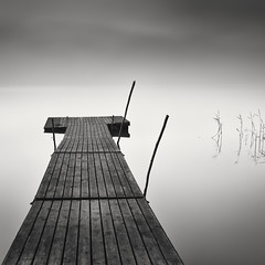 Sanbashi, part III (Vesa Pihanurmi) Tags: longexposure blackandwhite mist lake reed water monochrome lines fog espoo landscape sticks jetty calm le minimalism waterscape counterbalance