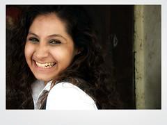 Camera shy (Parthurpics) Tags: portrait india girl smile face mumbai nikon1