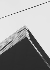 no tragedy here (itawtitaw) Tags: above light sky white abstract black building architecture facade contrast corner blackwhite shadows bright smooth korea lookup clear tiles edge seoul sw shape southkorea schwarzweiss minimalist divided fassade 30mm sigma30mm14 canoneos60d
