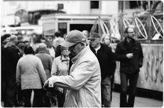 Undecided (gmacabre) Tags: street old portrait people urban blackandwhite bw white black film hat analog vintage photography grey alone faces pentax bokeh outdoor oldschool retro negative depression lonely melancholy authentic 135mm vechta