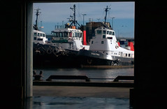 A tug at the door (Golux.) Tags: water boats scotland boat dock harbour shed quay aberdeen tugs tugboats cultra