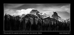Morning with Mt. Lougheed and the Wind Tower near Canmore, Alberta (kgogrady) Tags: landscape winter canmore alberta canada clouds canadianmountains cans2s bw albertalandscapes blackwhite canadianrockieslanscape canadianrockies 2017 blackandwhite ab canadianlandscapes westerncanada windtower xf18135mmf3556oiswr fujifilm fujifilmxt2 fujinon xt2 mtlougheed mountains acros panorama pano noone trees nopeople